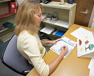 Image of researcher scoring assessment sheet